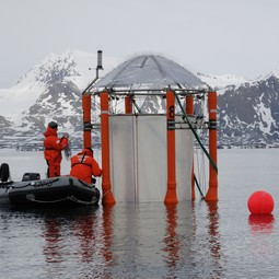 Researchers working on a mesocosm deployed for the ocean-acidification study