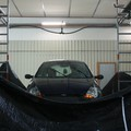 A car tested under a rain simulator