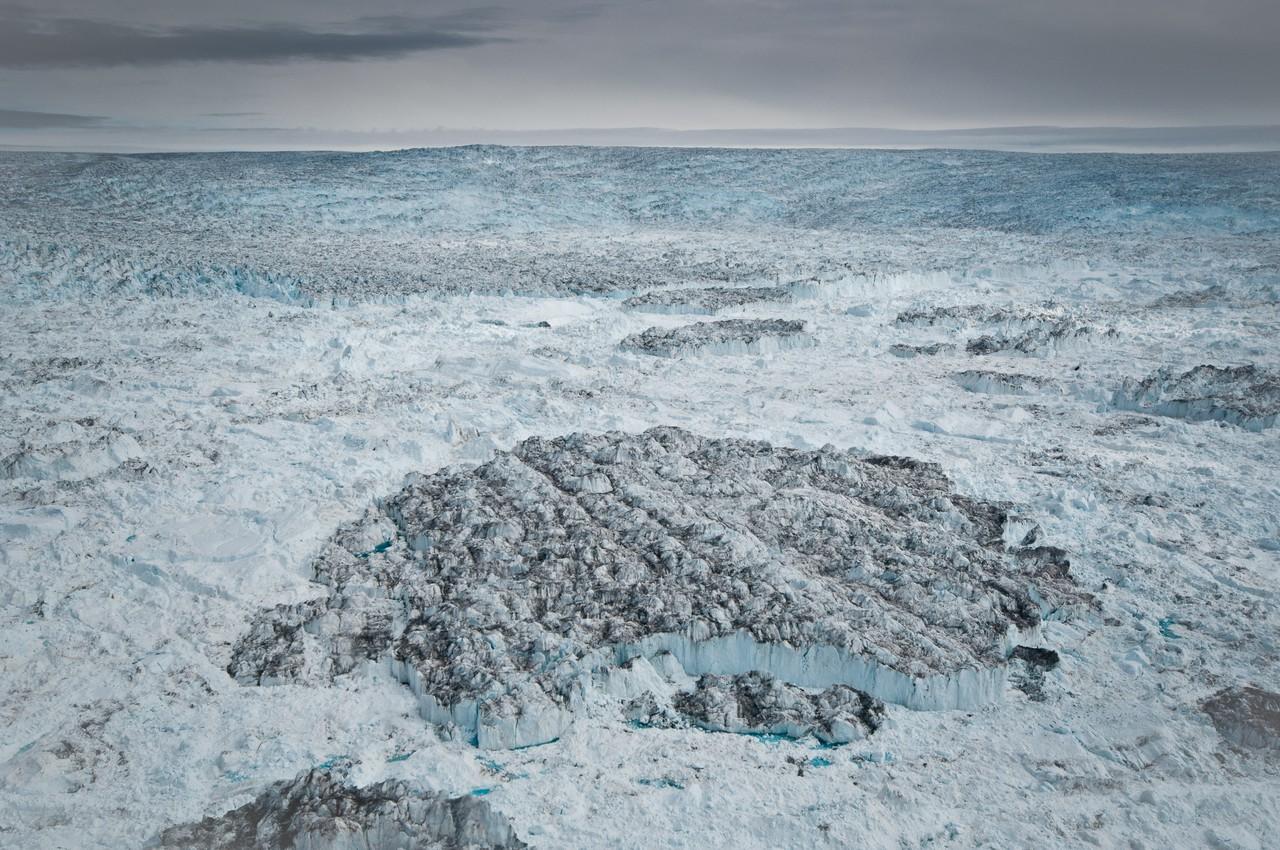 Tabular iceberg in front of the Jakobshavn Isbræ terminus (Credit: Ian Joughin, PSC/APL/UW)