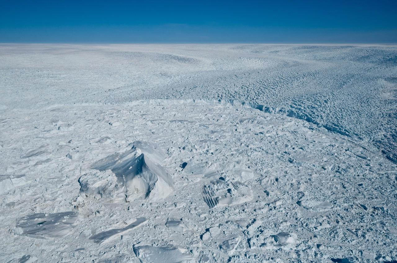 Iceberg in front of Jakobshavn Isbræ calving front (Credit: Ian Joughin, PSC/APL/UW)