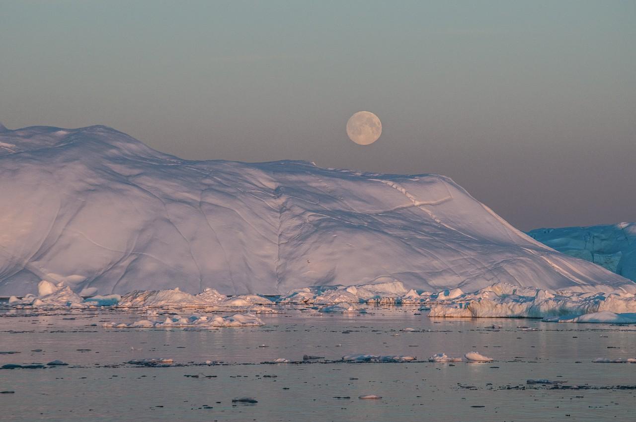 Moon over iceberg, Disko Bay (Credit: Ian Joughin, PSC/APL/UW)