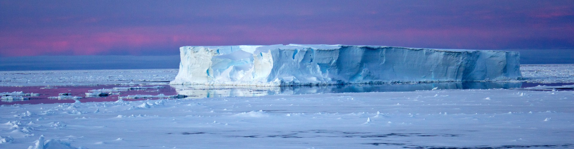 Tabular iceberg surrounded by sea ice in the Antarctic (Credit: Eva Nowatzki, distributed via imaggeo.egu.eu)