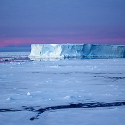 Tabular iceberg surrounded by sea ice in the Antarctic