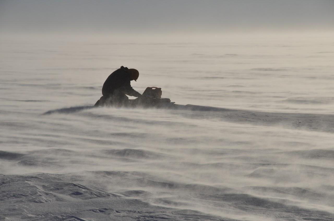 Study leader operating a radar on Pine Island Glacier (Credit: David Vaughan/BAS)