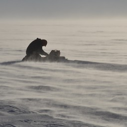 Study leader operating a radar on Pine Island Glacier