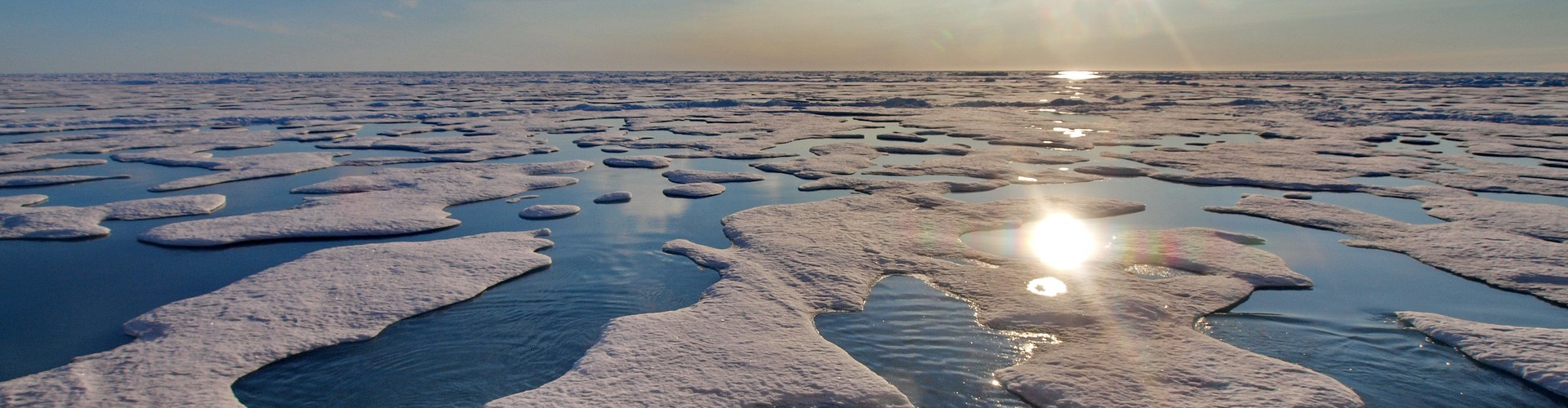 Ponds of melted freshwater (snow) on top of sea ice in the Arctic in summer. (Credit: Michael Tjernström, via Imaggeo)