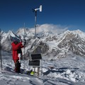 Taking measurements on Mera glacier in the Dudh Koshi basin (Everest visible in the background)