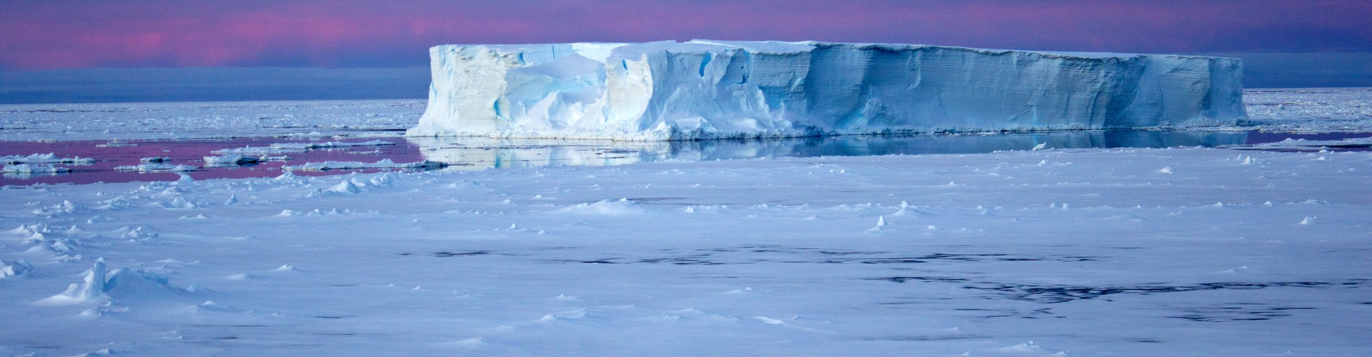 Iceberg surrounded by sea ice in the Antarctic (Credit: Eva Nowatzki, distributed via imaggeo.egu.eu)